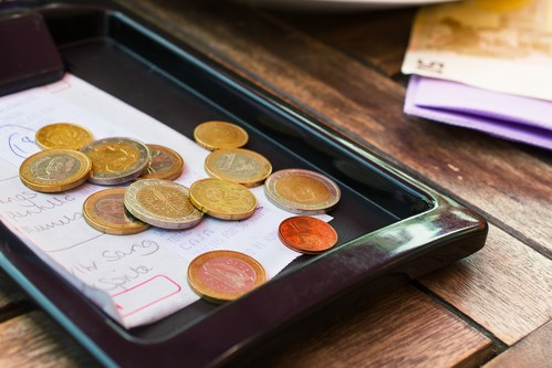 Meney left in a tip tray