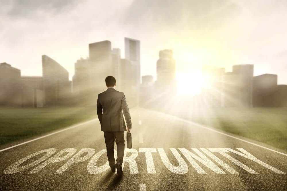 "Man walking on a road marked ""Opportunity."" Maybe this is the opportunity you've been waiting for to take that next step in your life."