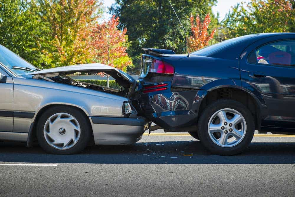 This picture of two cars collided can lead you to ask, does Doordash provide car insurance?
