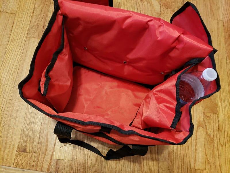 Interior flap holding a 1 liter water bottle inside it.