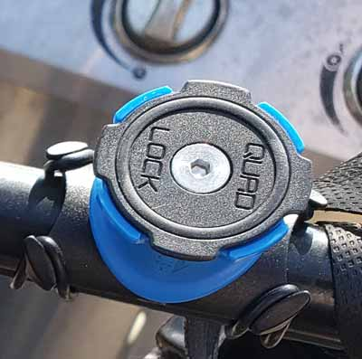 The Quad Lock phone mount on my handlebars. You just twist and lock the phone onto it. It mounts and unmounts quickly and efficiently and I'm finding it one of the most effective tools for delivering on e-Bike for Grubhub, Uber Eats and Doordash