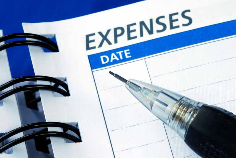 Pencil sitting on top of an expense book for recording delivery business related expenses.