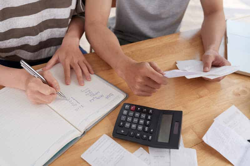 Delivery driver keeping record of expenses, receipts and miles