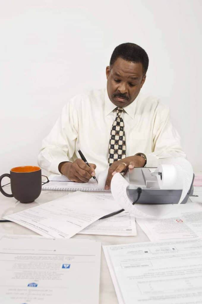 Accountant working on taxes and accounting for delivery contractors.