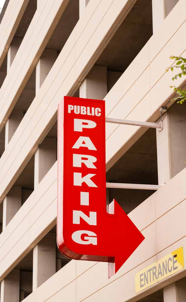 Sign to a parking garage where costs are deductible if for business purposes
