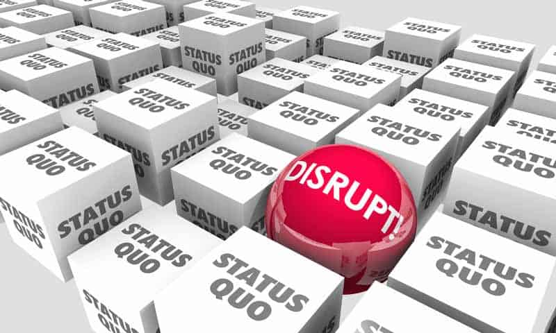 Red Disrupt ball amid several plain Status Quo boxes