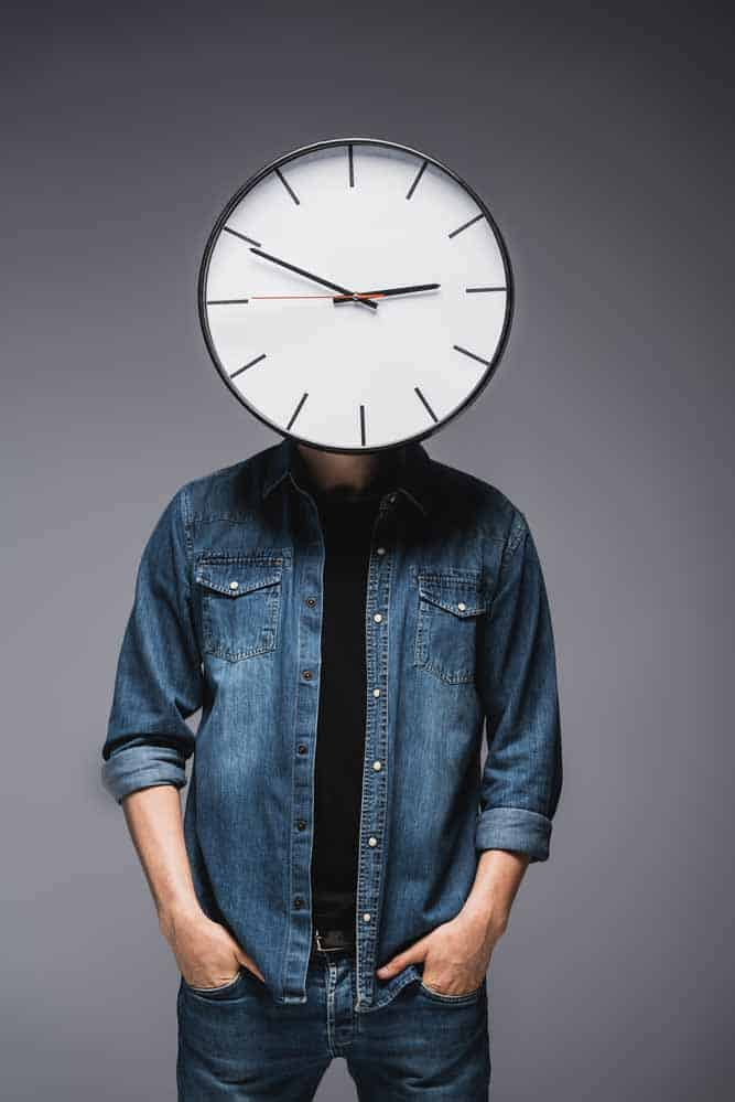 efficient delivery driver with a clock for a head thinking time is money.