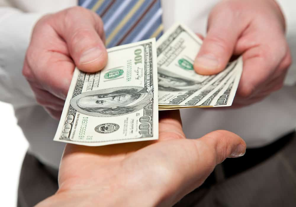 Person handing out money