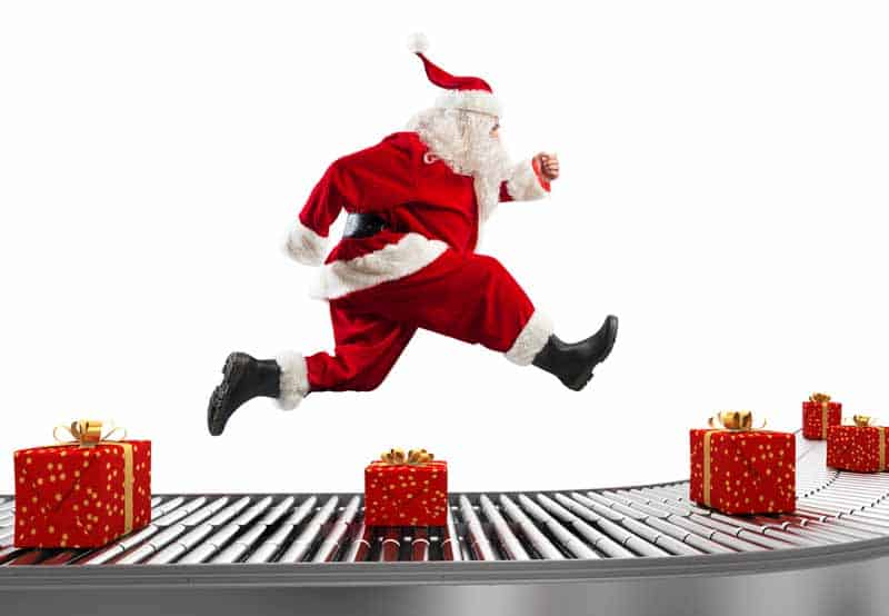 santa running over a conveyor belt with gifts for delivery