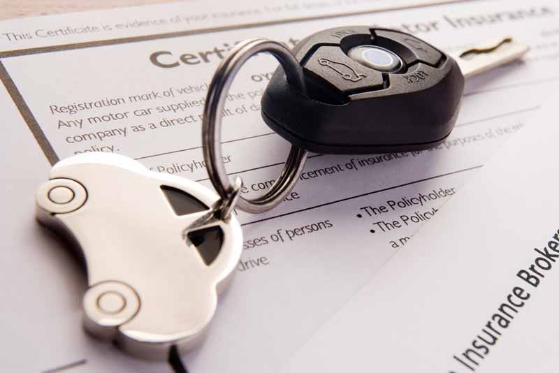Car keys sitting on top of Grubhub contractor's auto insurance documents