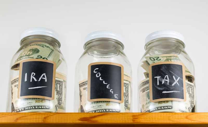 Three jars with savings for retirement, college and self employment taxes