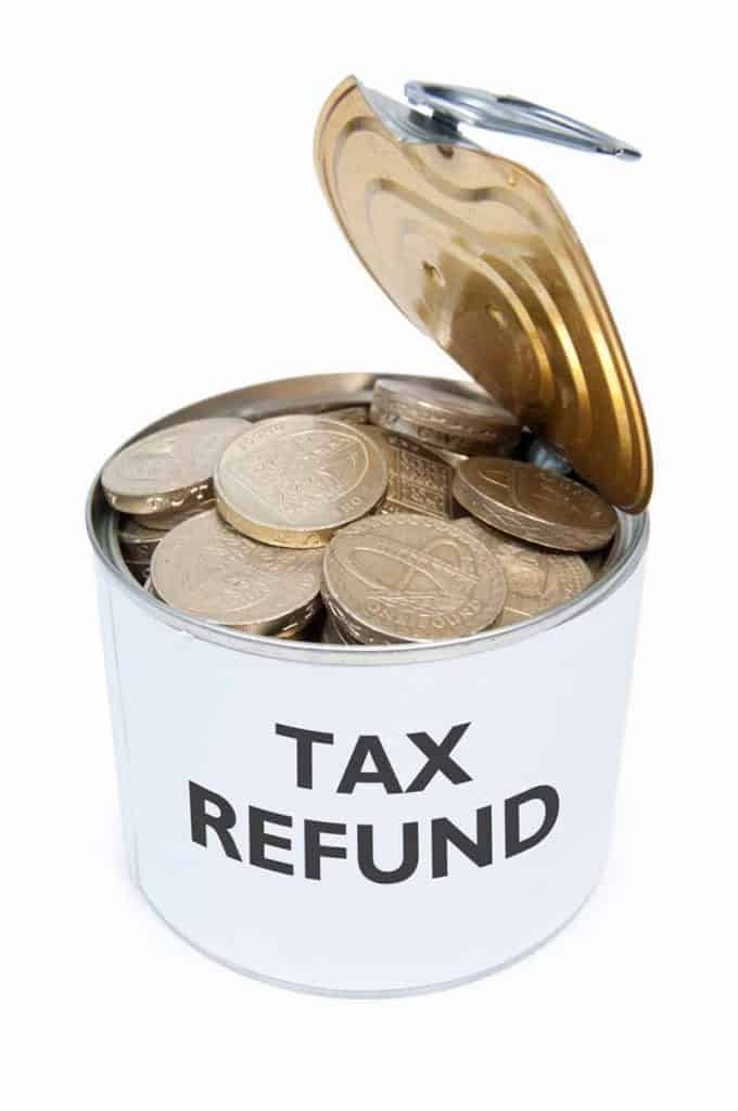 Coins in a tin can labeled Tax Refund