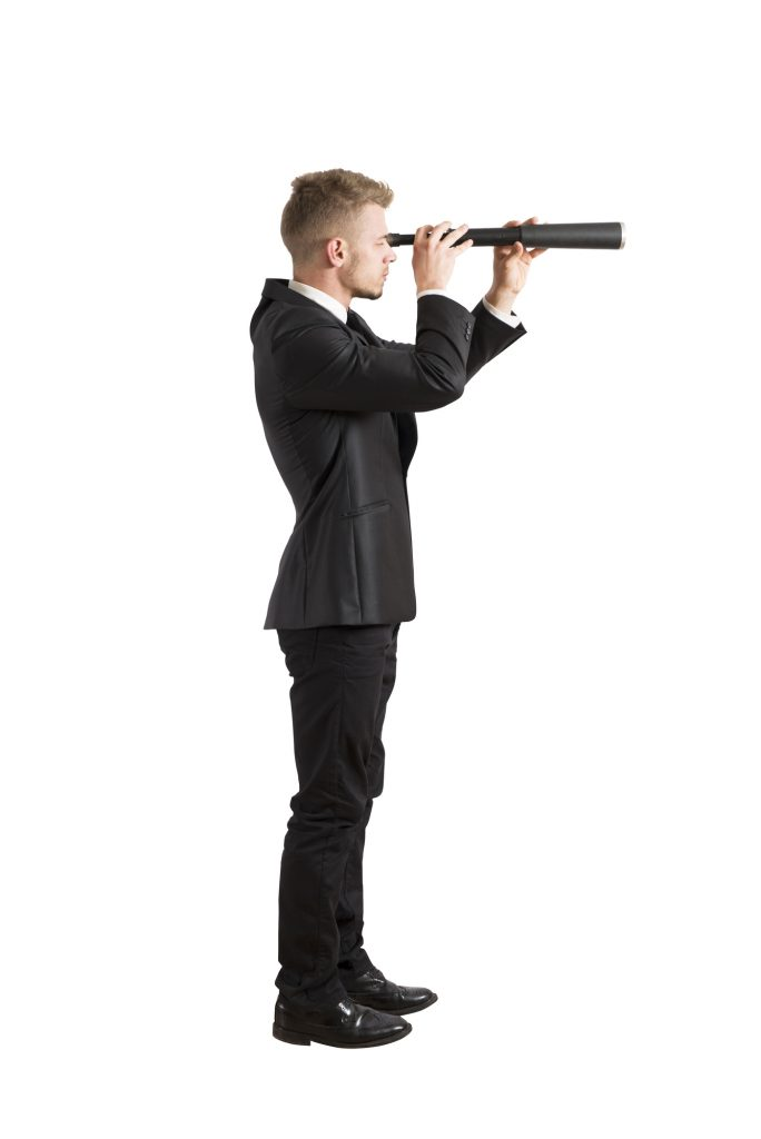 businessman with telescope looking to the future