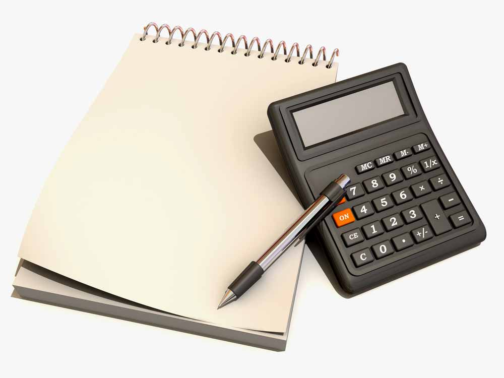 Picture of calculator, pen, and notepad for calculating eligibility for the paycheck protection program