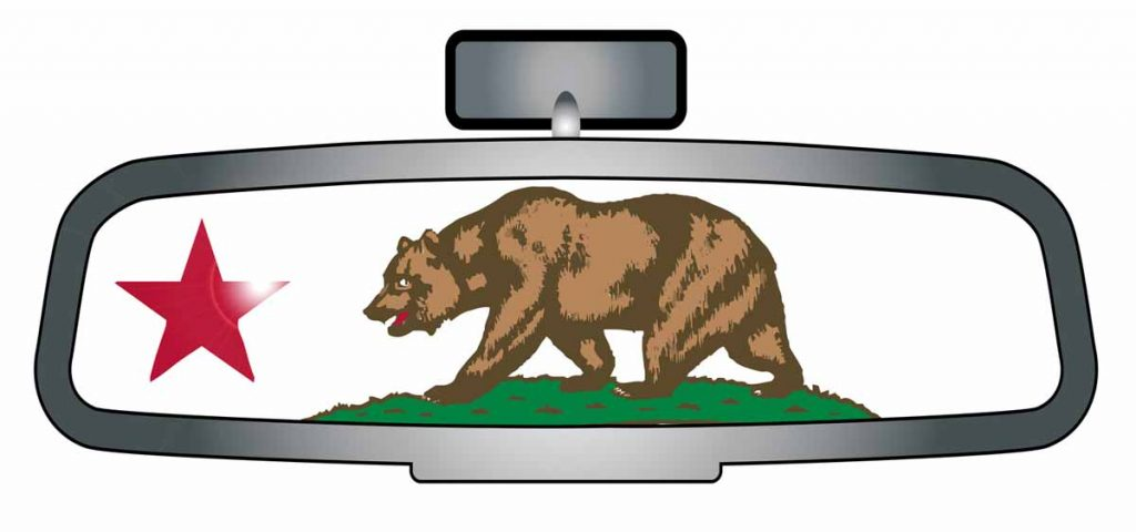 rearview mirror with a bear and red star symbolizing the republic of California