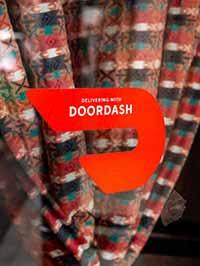 A Doordash sign on a restaurant door