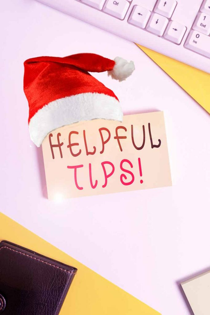 """Hellpful tips"" written on a post-it with a santa hat"