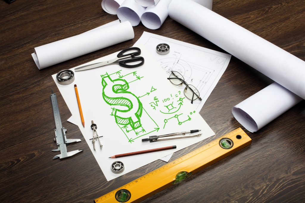 Financial symbols on sheet of paper surrounded by several tools symbolizing financial tools