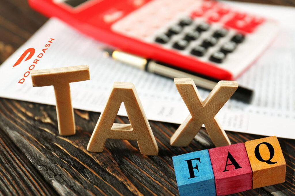 Calculator and pen on paper with Doordash letterhead, blocks spelling Tax FAQ