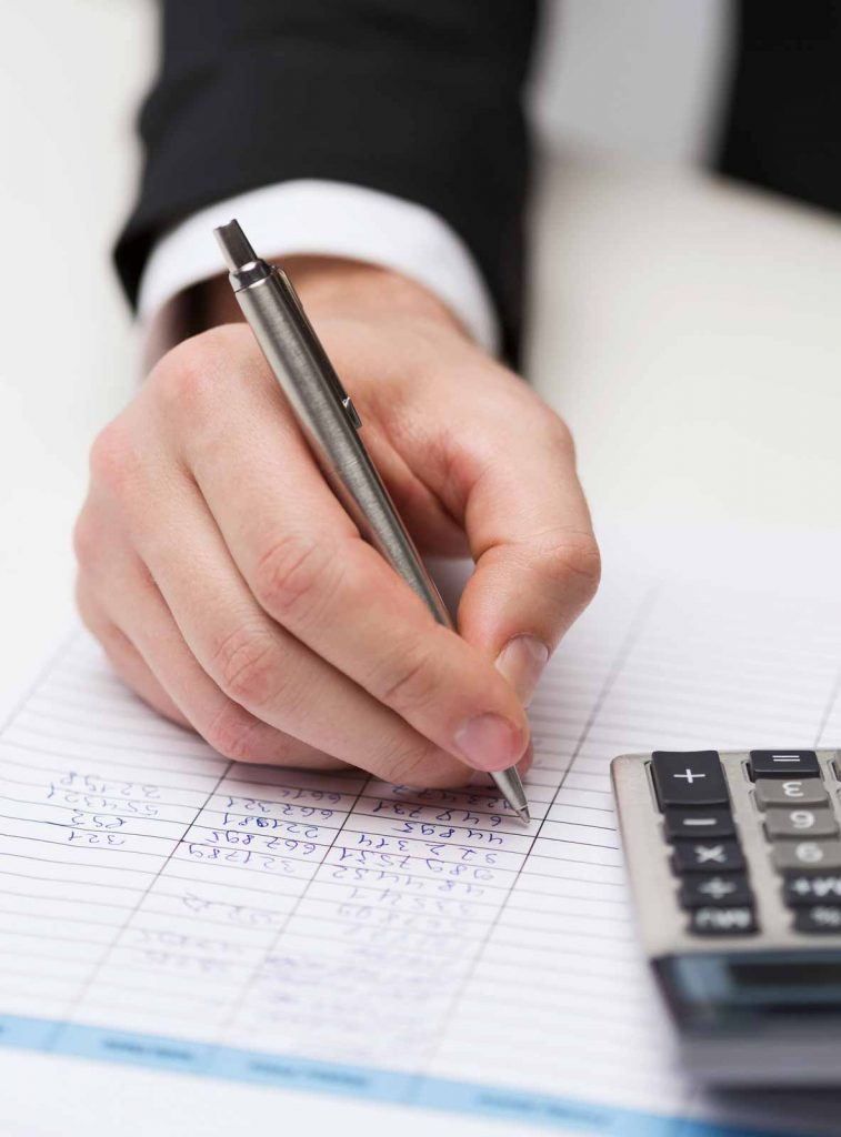 Man using pen calculator and ledger as tools for bookkeeping
