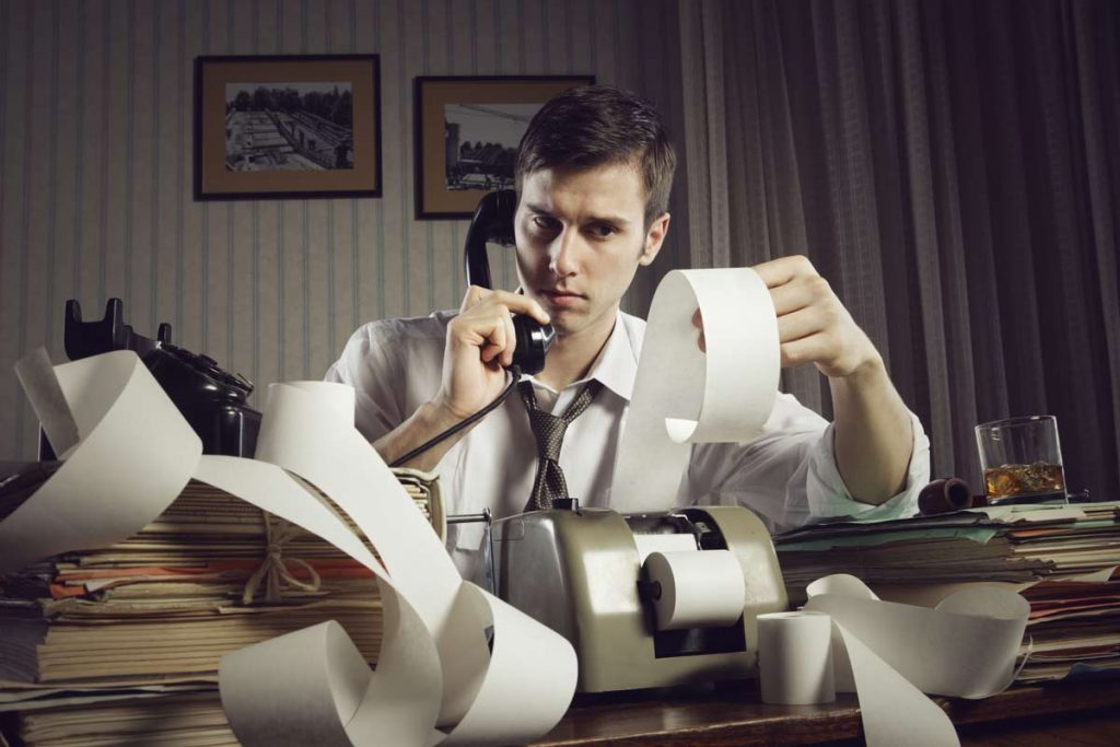 Independent contractor with books, adding machine, phone running taxes