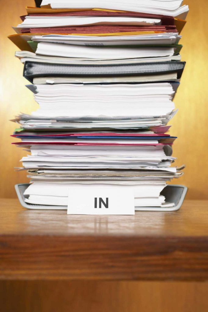 Large stack of books and documents