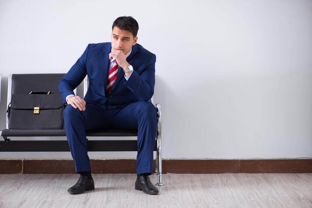 Man waiting at an airport waiting room.