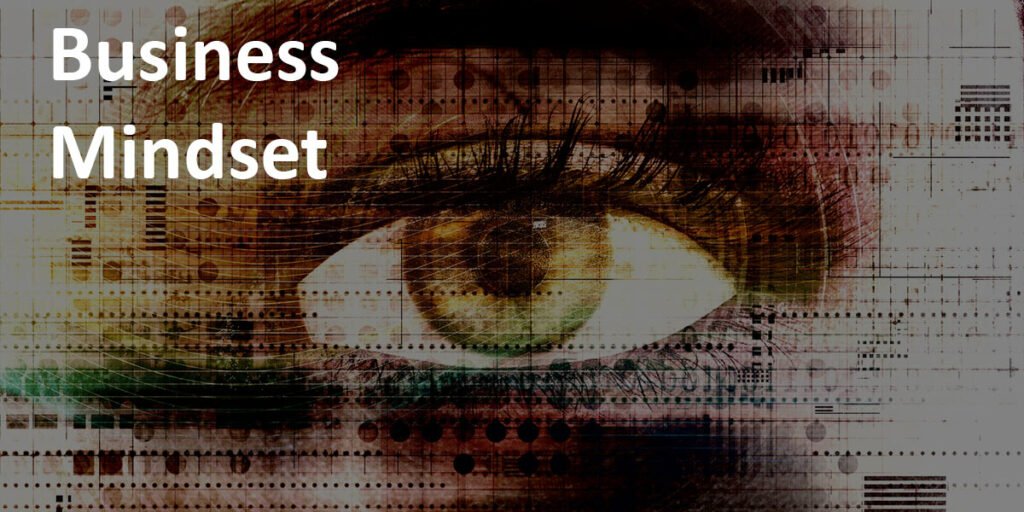 """Business Mindset"" label over abstract image of a human eye with a technical theme."