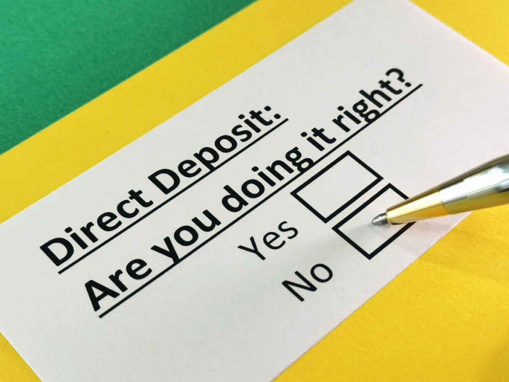 White slip of paper on yellow background with question: Direct Deposit: Are you doing it right? A Pen hovers over yes and no check boxes.