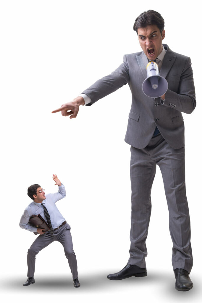 Angry controlling boss shouting at smaller employee through a megaphone