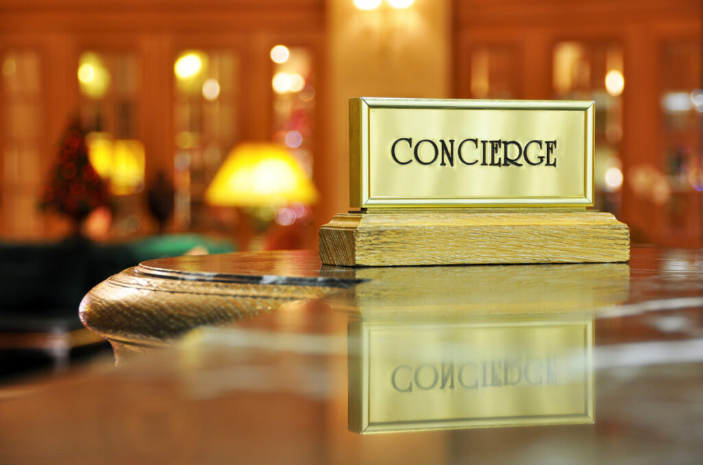 Concierge sign on a nice desk in a luxury hotel or condominium community.