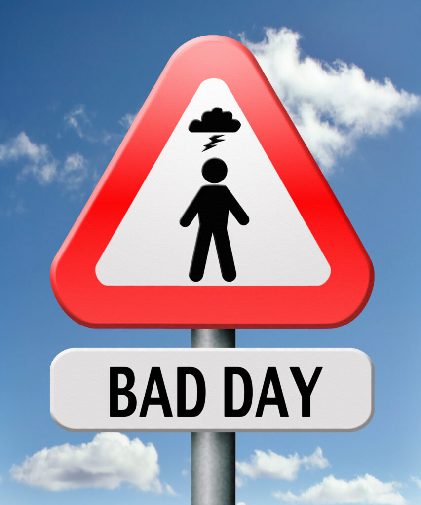 Sign that says Bad Day with red triangle icon of a person figurine and a thunder cloud overhead.