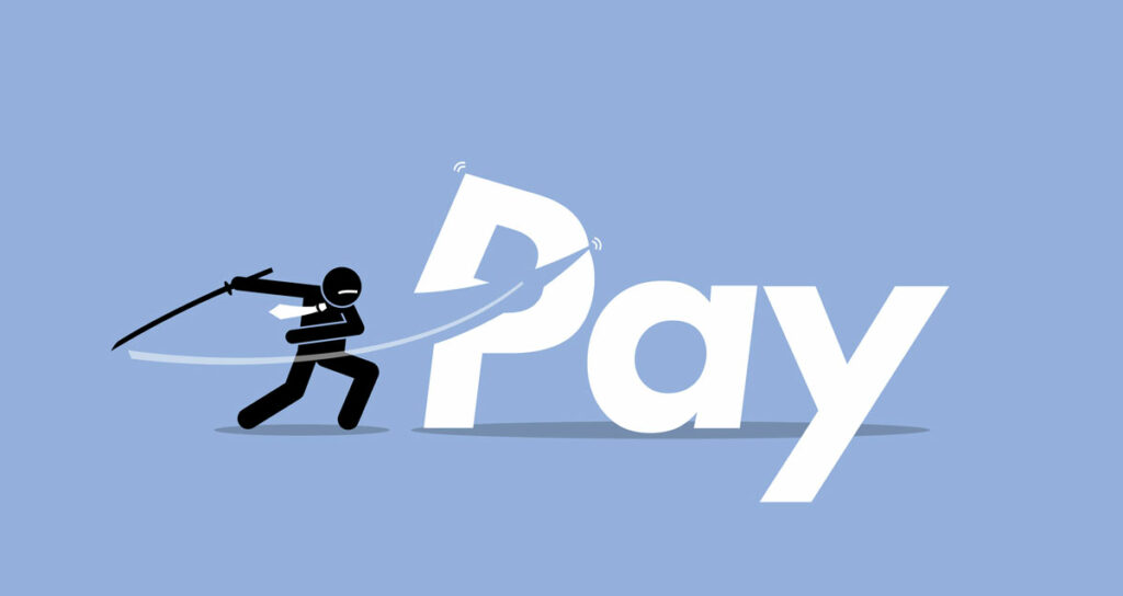 Pay cut concept illustrated by ninja figurine chopping the P in Pay with a sword.