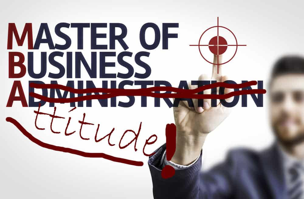 """Business man drawing out words Master Business Administration, Administration is crossed out and replaced by handwritten """"Attitude."""""""