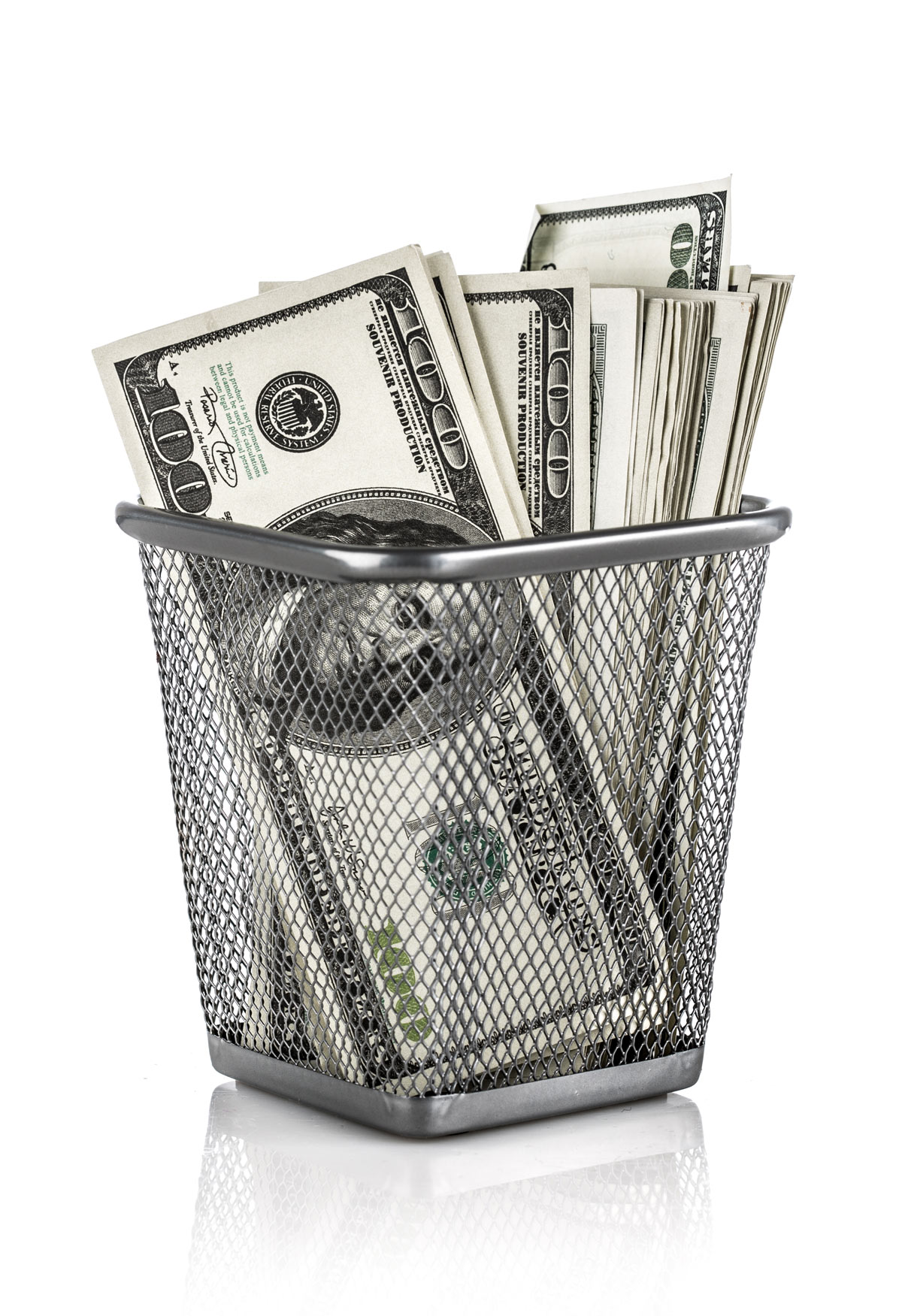 Small wire basket with a stack of $100 bills.