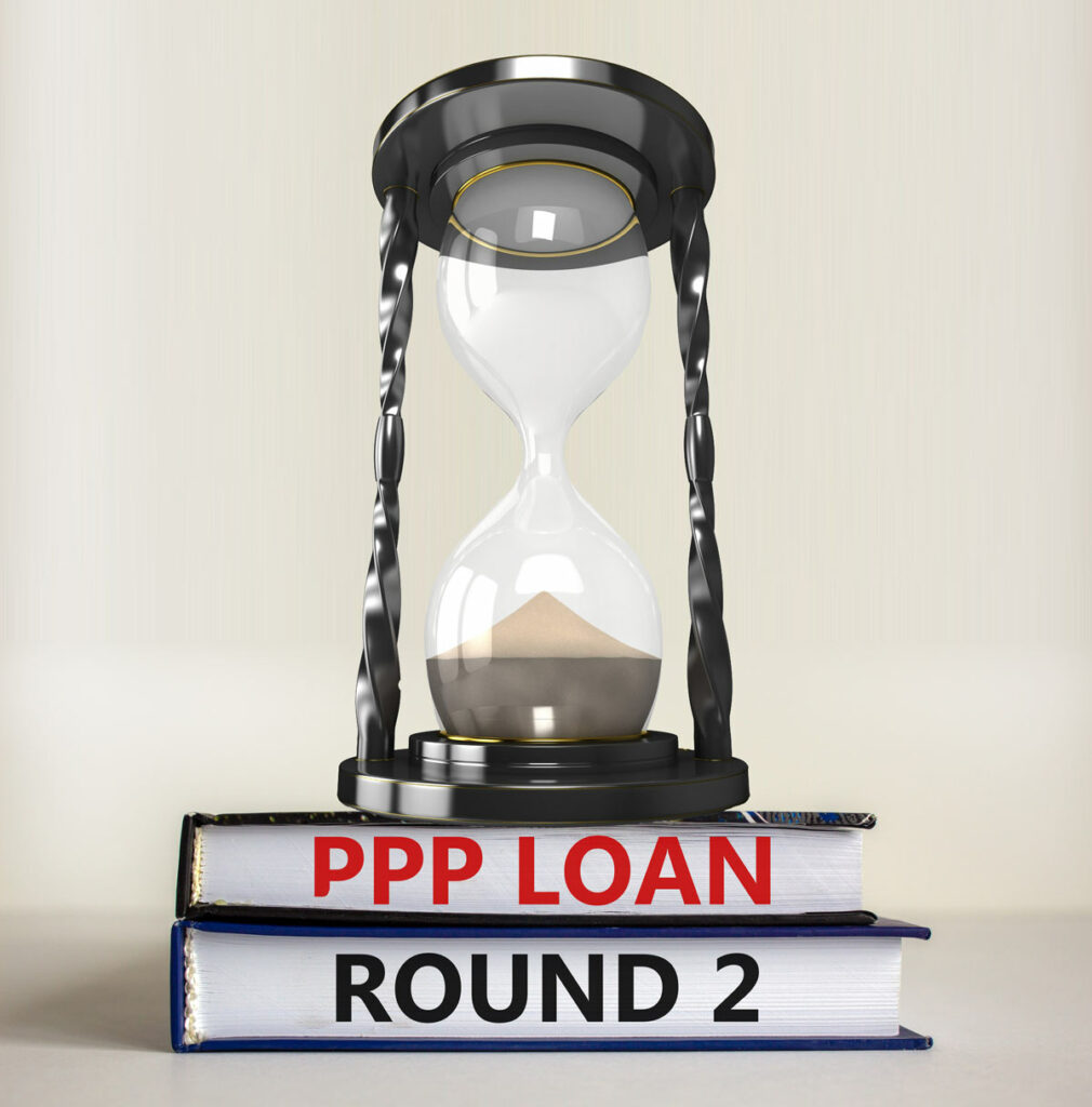 Empty hourglass on stack of books labeled PPP Loan Round 2, indicating time running out on the Paycheck Protection Program.