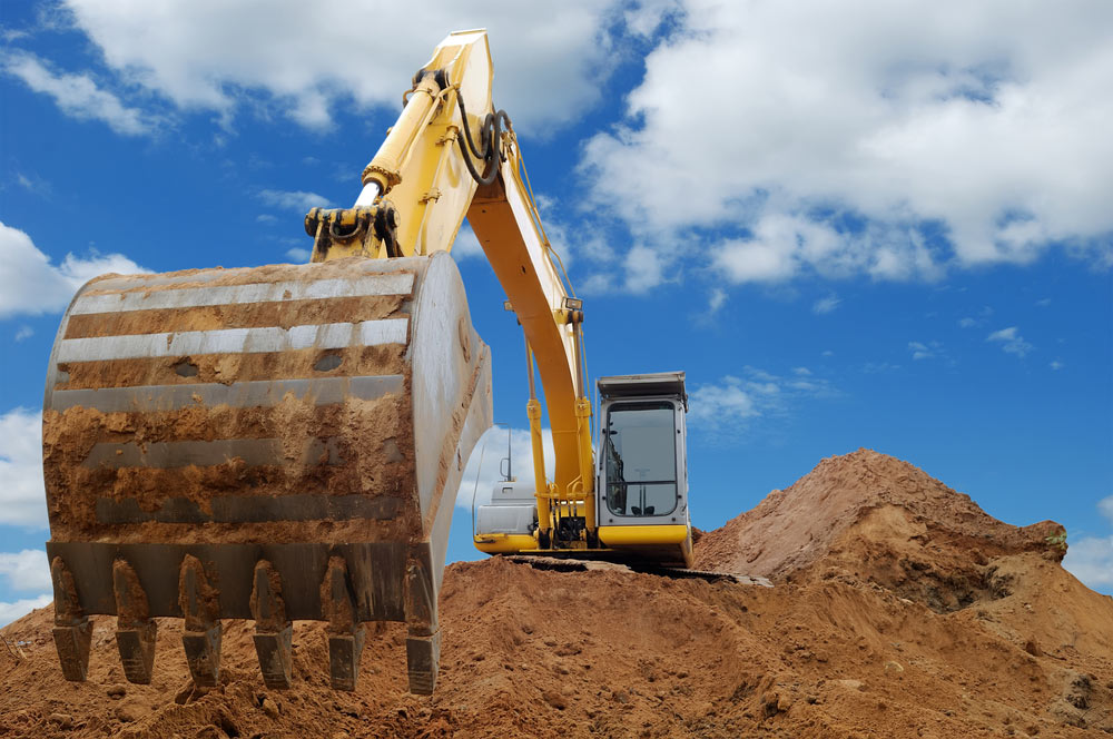 Digging your way out of debt with a bigger shovel illustrated by a large back hoe.