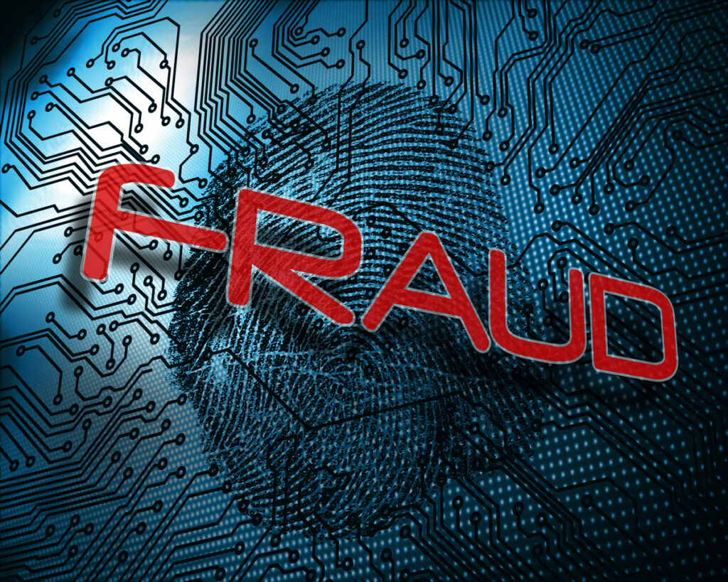 Digital fraud concept illustrated by a circuit board with a fingerprint on it, with the word Fraud in red letters hovering over it.