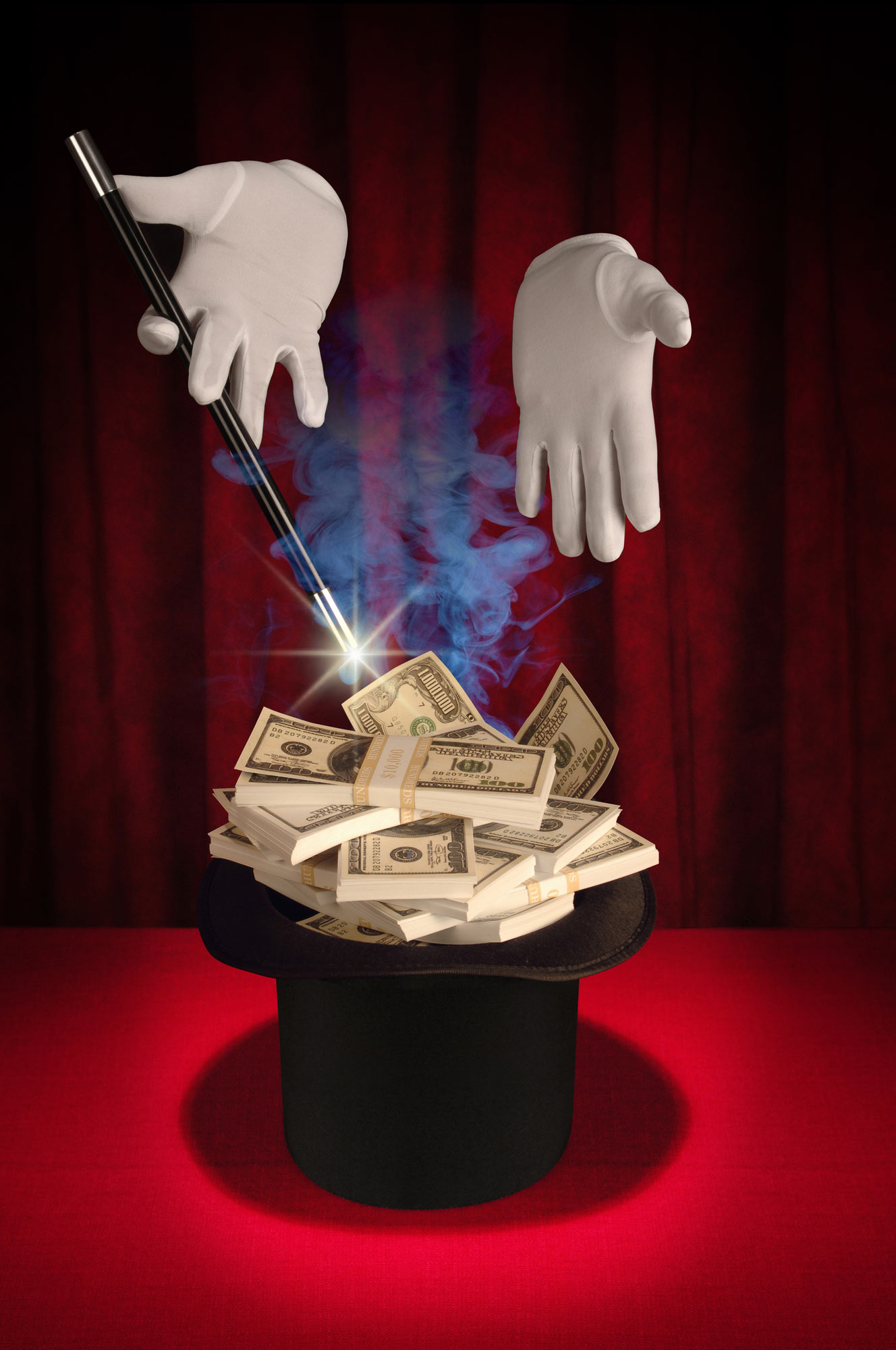 Smoke and mirrors magic trick that creates an illusion that stacks of money are appearing in the Magician's top hat.