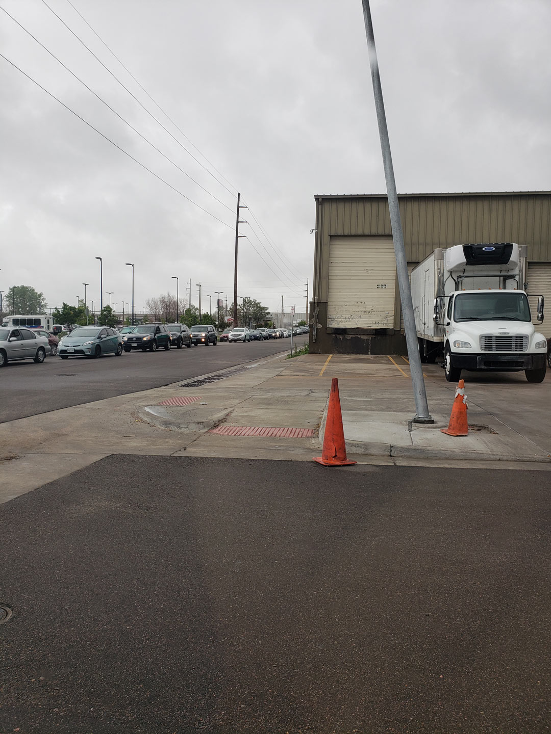 The line of cars waiting to get into the Veho warehouse on Memorial Day morning stretched more than two blocks.