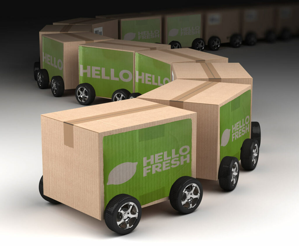 Veho Package Delivery illustrated by a train of Hello Fresh meal boxes.