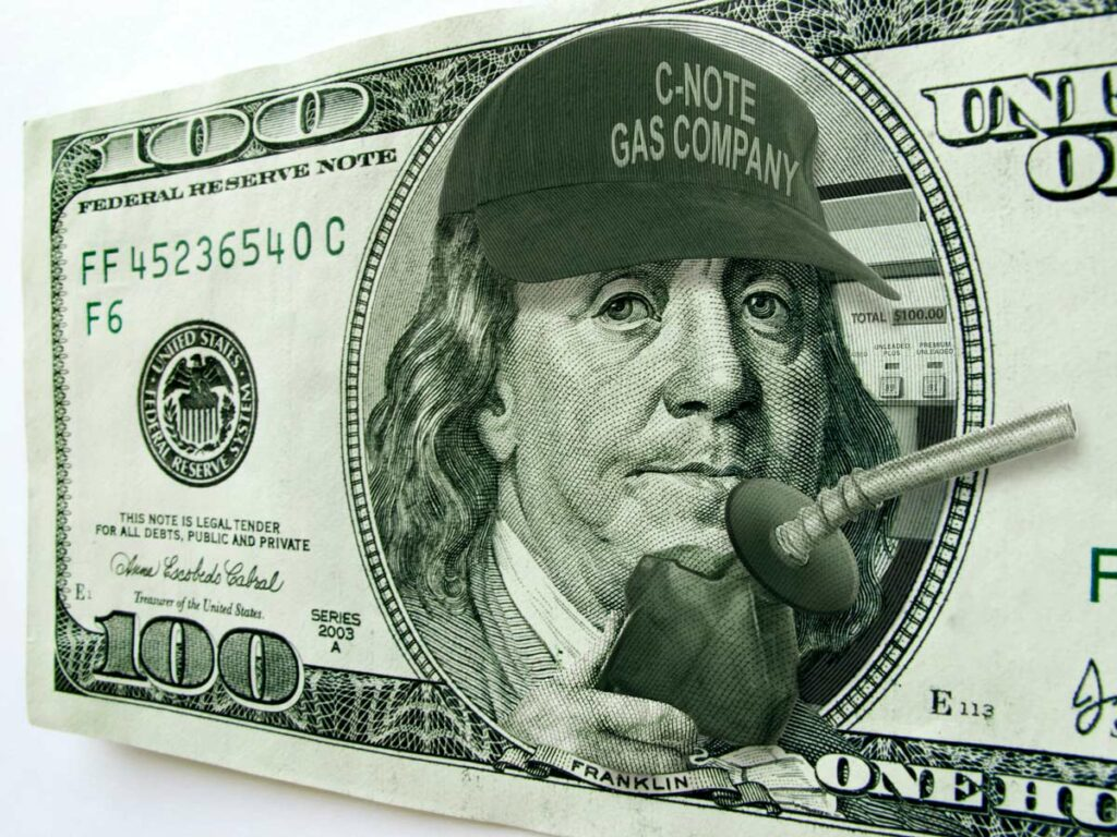 A $100 bill with Ben Franklin holding a gas nozzle and a gas pump behind him showing $100.00 as the price.