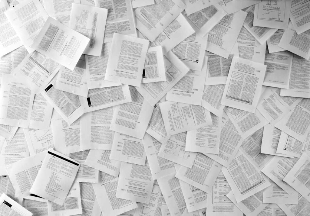 Hundreds of documents piled up on one another, an image that comes to mind for many when we think of PPP loan forgiveness documentation.