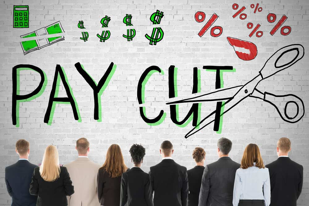 A group of Dashers looking up at a brick wall where Pay Cut is written, along with an image of scissors, dollars and dollar signs cut in half, along with a Doordash logo.