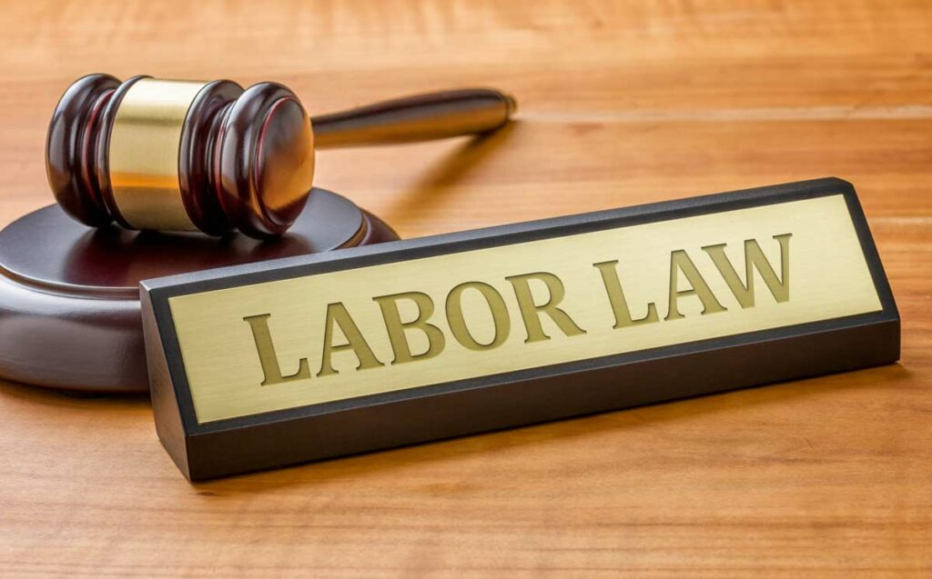 A gavel on a judge's desk with a sign that reads Labor Law